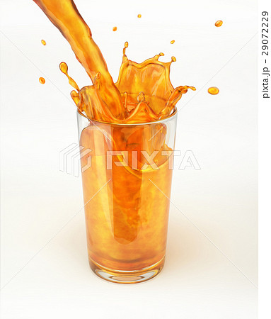 Orange juice pouring into a glass, forming a splash. 29072229