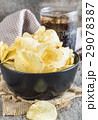 Potato chips in bowl with cola on wooden. 29078387