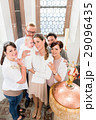 Family with baby standing at the baptismal font 29096435