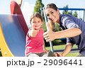 Mother and little girl chuting at playground  29096441