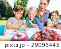 Mum painting pictures with their children  29096443