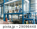 Three workers in the office of a modern factory 29096448