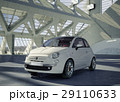 Fiat 500 city car, alone in the middle of a huge modern building environment. 29110633
