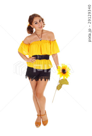 Beautiful woman with one sunflowers. 29129340