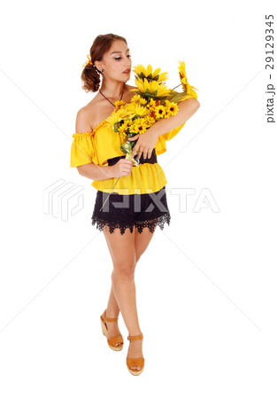 Beautiful woman standing with sunflowers. 29129345
