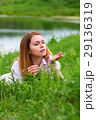 Young woman relaxing on nature 29136319