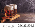 Cold beer in glass on a dark background. 29161548