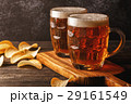 Cold beer in glass on a dark background. 29161549