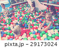 children playing together in pool with plastic multicolored balls 29173024