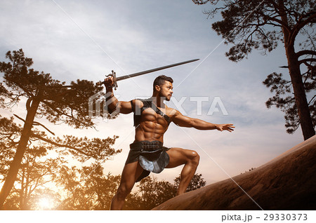 Young muscular warrior with a sword at the 29330373