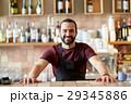 happy man, barman or waiter at bar 29345886