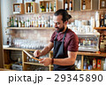 happy man or waiter with chalkboard banner at bar 29345890