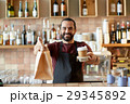 man or waiter with coffee and paper bag at bar 29345892