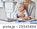 businesswoman with baby working at office 29345894