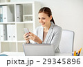 businesswoman with smartphone at office 29345896