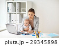 businesswoman with baby working at office 29345898