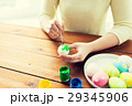 close up of woman hands coloring easter eggs 29345906