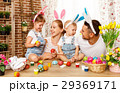 easter! mother, father and children paint  eggs 29369171