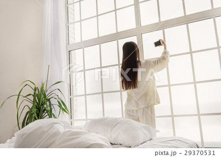 Calm woman making selfie by cellphone 29370531