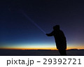 Silhouette of a man with a flashlight, observing 29392721
