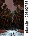 Man with flashlight in forest 29392786