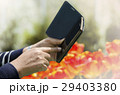 Woman useing smartphone in the garden 29403380
