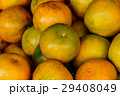 Oranges are sold in local markets in Thailand. 29408049