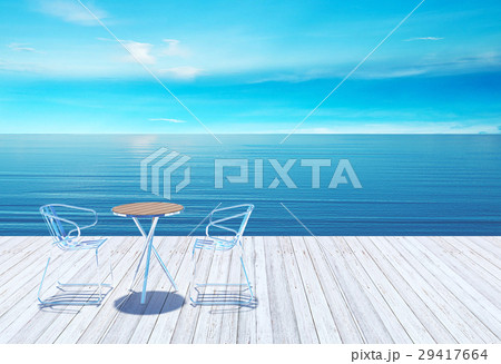 Outdoor terrace with table and chairs over sea 29417664