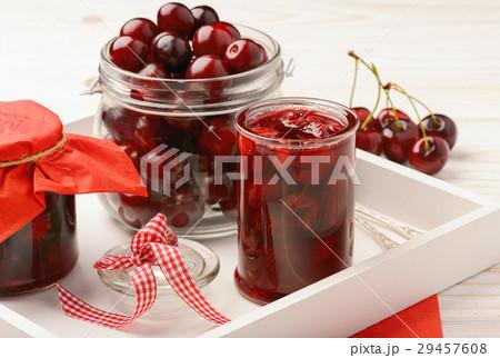 Cherry jam in glass jars on wooden background.の写真素材 [29457608] - PIXTA
