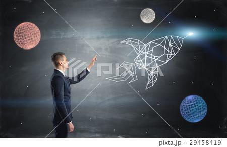 businessman on blue chalkboard background isの写真素材 29458419
