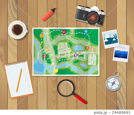 Wooden table with paper map. Planning trip 29489691