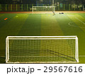 View of people playing football on the ground 29567616