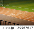 View of people playing football on the ground 29567617