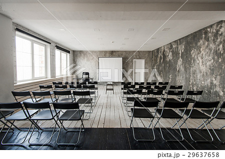 Empty modern classroom with black chairs projector 29637658
