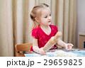 A child rolling a dough 29659825