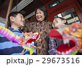 Asian family in front of store 29673516