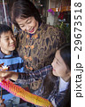 Asian family in front of store 29673518