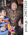 Asian family in front of store 29673520