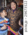 Asian family in front of store 29673522