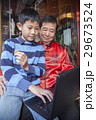Asian family in front of store 29673524