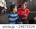 Asian family in front of store 29673526