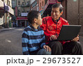 Asian family in front of store 29673527
