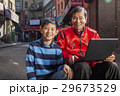 Asian family in front of store 29673529