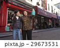 Asian family in front of store 29673531