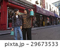 Asian family in front of store 29673533