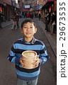 Boy holding dumplings 29673535