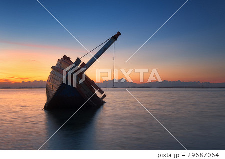 Wrecked wooden fishing ship at coastline  29687064