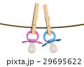 blue and pink babies pacifiers on rope 29695622
