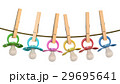 Row of babies pacifiers on rope with pins 29695641