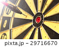 Red dart arrow hitting in the target center  29716670
